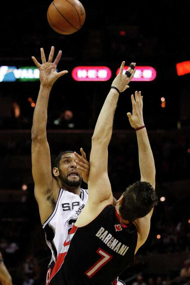SPURS -- San Antonio Spurs Tim Duncan shoots over Toronto Raptors Andrea Bargnani during the second half at the AT&T Center, Wednesday, Jan. 19, 2011. The Spur won 104-95 and improve to 36-6. JERRY LARA/glara@express-news.net Photo: JERRY LARA, San Antonio Express-News / glara@express-news.net