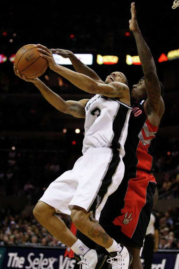 SPURS -- San Antonio Spurs George Hill tries to get by Toronto Raptors 