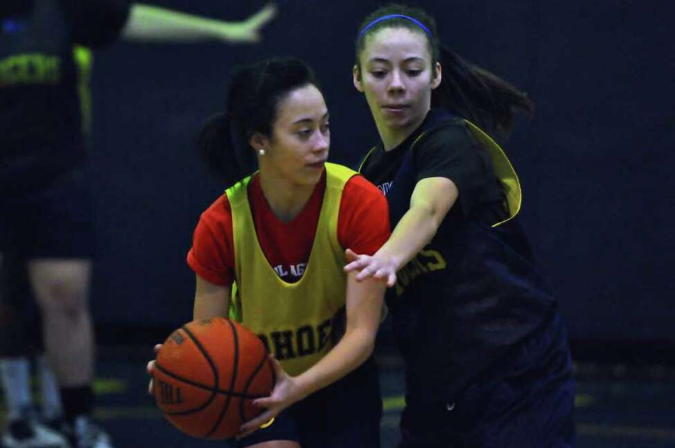 Cohoes' My'Asia Alston, right, defends her sister and teammate Shadasia during practice. (Philip Kamrass / Times Union )