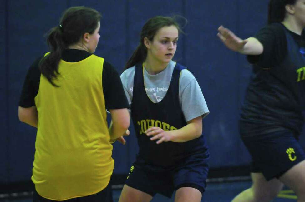 Cohoes' Bailei Tetrault, center, works on plays during practice. (Philip Kamrass / Times Union )