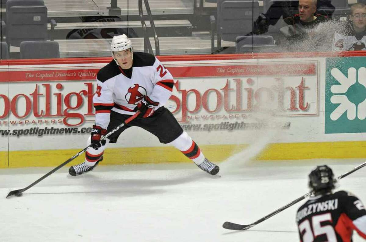 Alexander Vasyunov of the Albany Devils looks for an open man to pass the puck to. (Lori Van Buren / Times Union)