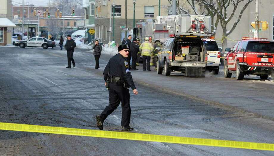 Schenectady police shut down parts of Liberty Street near the main post office building and City Hall Thursday after a propane tank was found in the road.  (Skip Dickstein / Times Union) Photo: SKIP DICKSTEIN / 2008