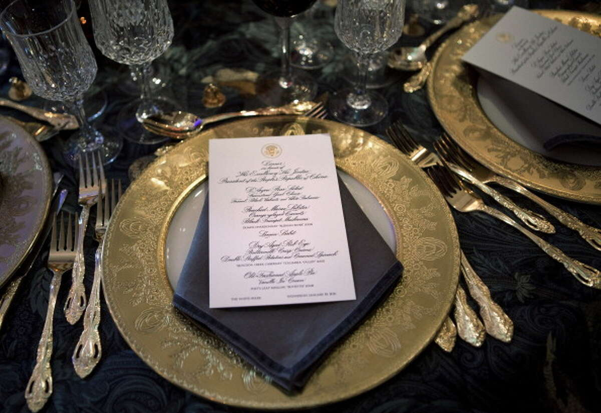 WASHINGTON - JANUARY 19: A place setting with the menu sits on a table in the Blue Room of the White House 19, 2011 in Washington, DC. President Barack Obama and first lady Michelle Obama are hosting Chinese President Hu Jintao for a state dinner during his visit to the United States. (Photo by Brendan Smialowski/Getty Images)