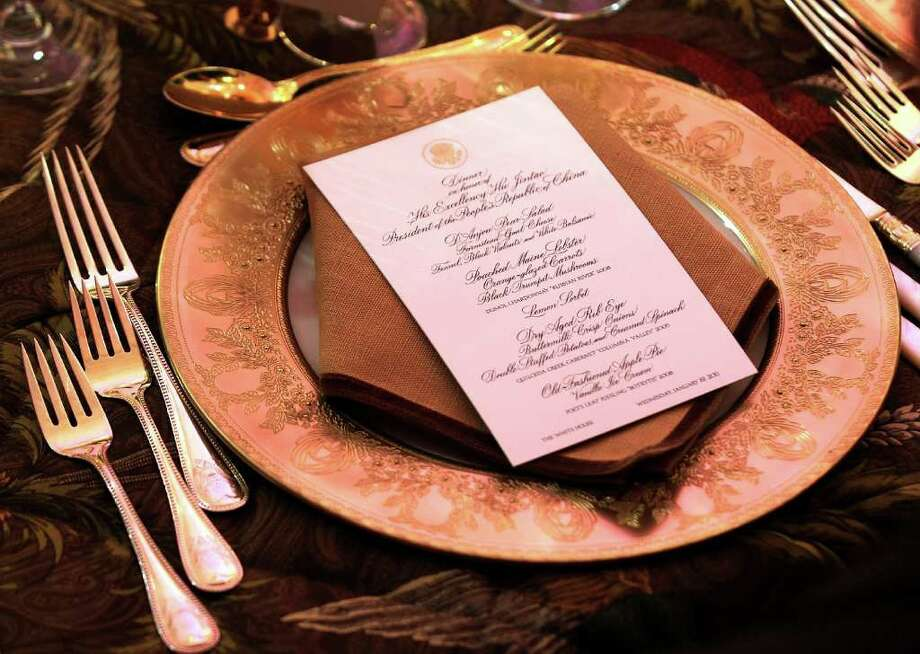 WASHINGTON, DC - JANUARY 19:  The menu of the state dinner for Chinese President Hu Jintao is seen during the dinner at the State Dining Room of the White House January 19, 2011 in Washington, DC. Obama is hosting a state dinner for Hu's state visit to the United States this evening.  (Photo by Alex Wong/Getty Images) Photo: Alex Wong, Getty Images / 2011 Getty Images
