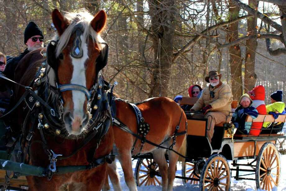 Those going to the sled hill were treated to a horse-drawn cart ride during the Frost Faire winter festival at Saratoga National Historic Park. (MICHAEL P. FARRELL / TIMES UNION) Photo: Michael P. Farrell / 00001721A