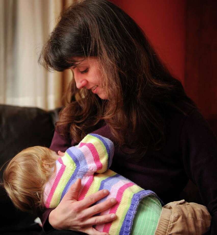 Jodi Palmieri, an RN and La Leche League leader, nurses her eighteen-month-old daughter Natasha Schumann Thursday Jan. 20, 2011 at their home in Stratford. Photo: Autumn Driscoll / Connecticut Post