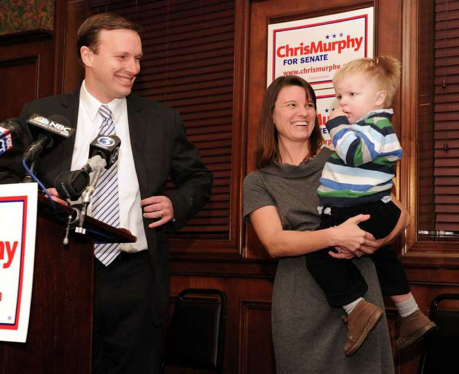 Congressman Chris Murphy, standing with his wife Cathy Holahan and son Owen, 2 1/2, announces his intention to seek the Senate seat now held by Joe Lieberman. Photo: Carol Kaliff / The News-Times