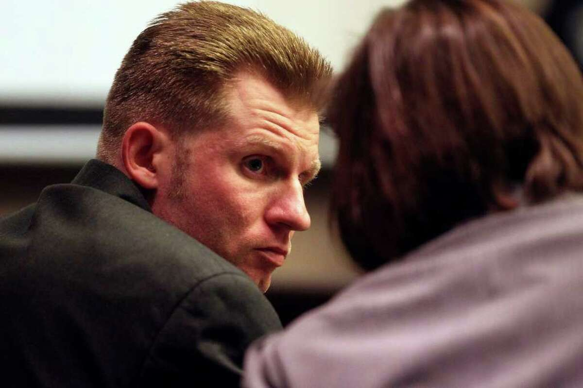 Thomas Ahrens (left) listens to an attorney during the punishment phase of his trial. He was convicted of killing Christopher Duncan in February 2008.