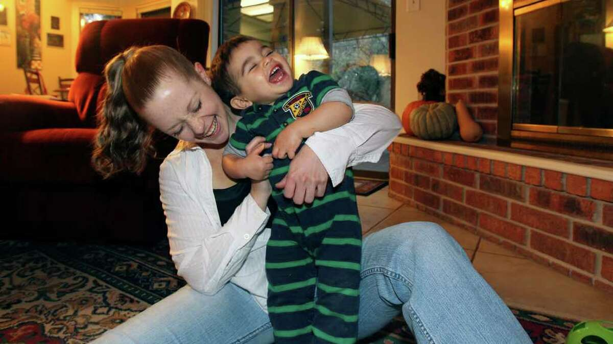 Megan Thompson plays with her son Tristan. She entered the Preparing Adults for College Excellence program to get her GED and plans to become a radiology technician.