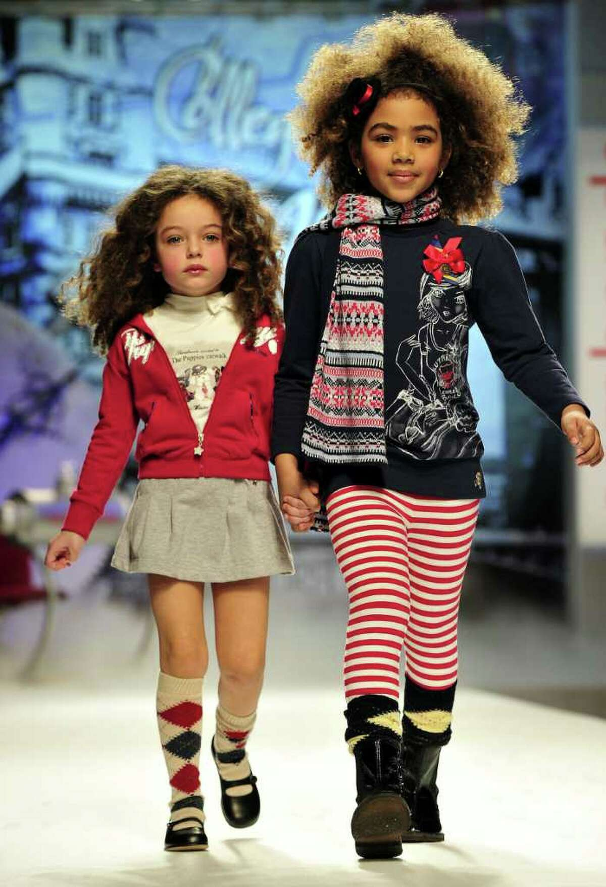 Models present creations of the collection of Italian design label Sarabanda at the annual 'Pitti Bimbo' fashion show for children, in Florence Italy, Thursday Jan. 20, 2011.