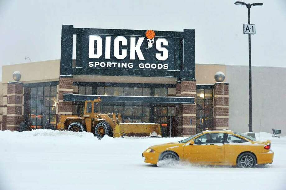A plow clears the parking lot at the Danbury Fair mall, Friday, Jan. 21, 2010. Photo: Michael Duffy / The News-Times