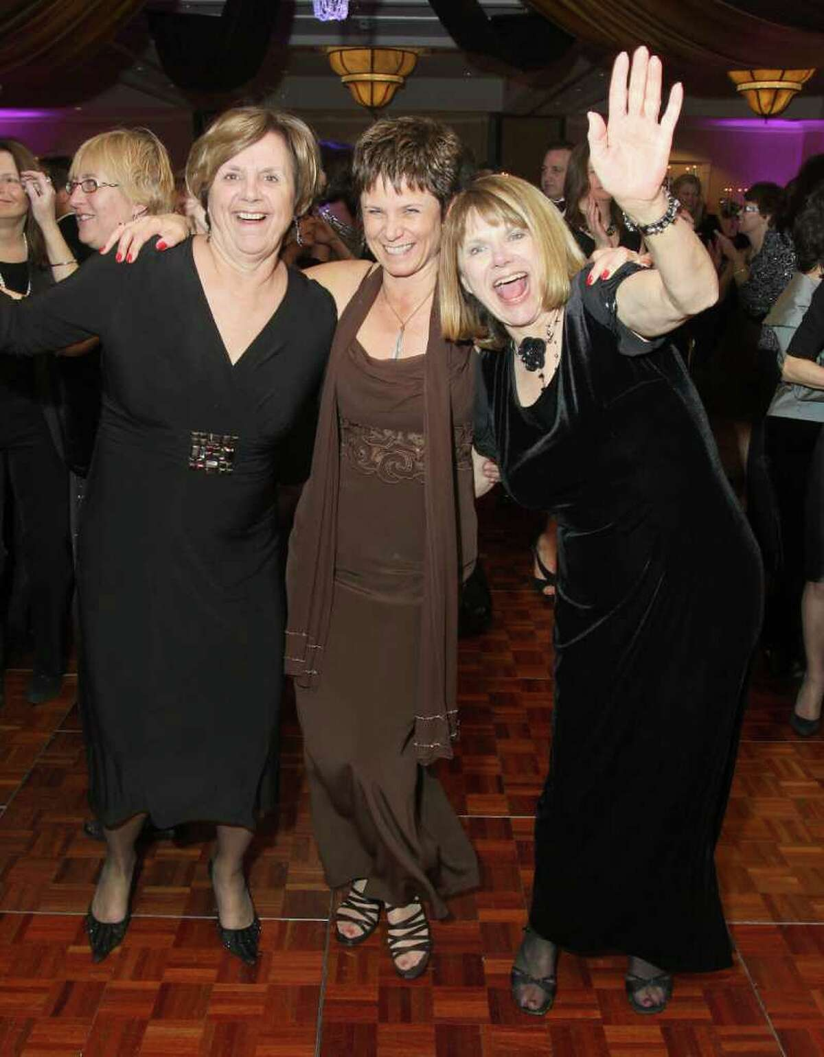 From left: Gloria Schreiner, Nancy Lawler and Barbara Malfetano hit the dance floor. (Joe Putrock / Special to the Times Union)