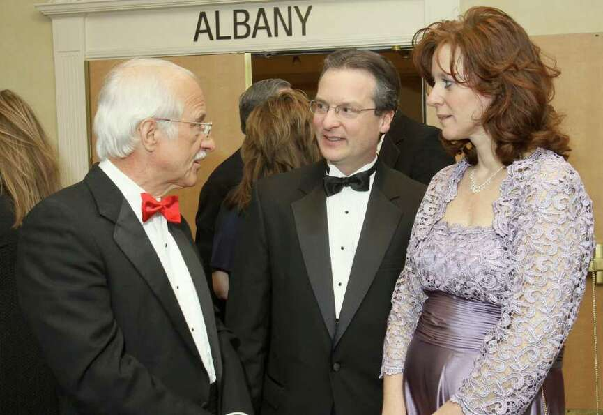 Dr. Martin Echt, left, talks with Karl and Lori Cote. (Joe Putrock / Special to the Times Union)