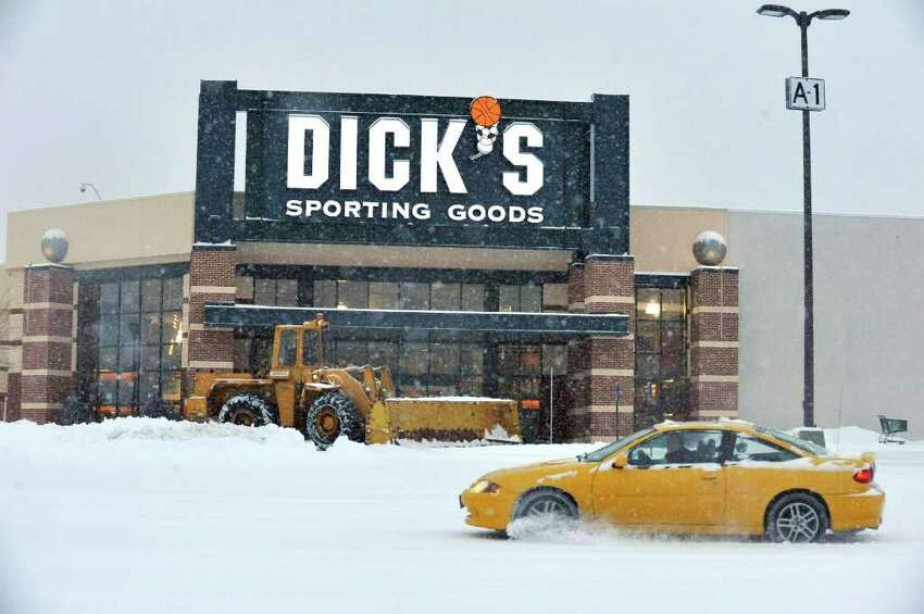 A plow clears the parking lot at the Danbury Fair mall, Friday, Jan. 21, 2010.