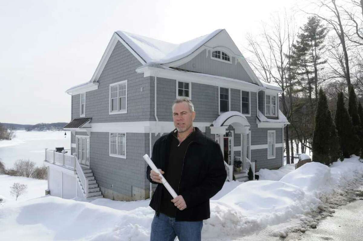 Bob Schirmer, owner of Pine Ridge Building, LCC, in New Fairfield, stands outside of his Candlewood Lake home which he renovated from a four-season lake cottage to a full-size custom home. Photo taken on Thursday, Jan. 20, 2011.