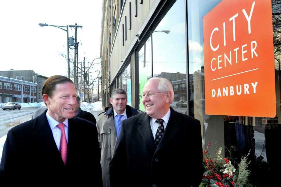 """U.S. Sen. Richard Blumenthal, left, talks with Wayne Shepperd, mayor's chief of staff, during a """"Listening Tour"""" of Danbury. Steve Bull, president of the Greater Danbury Chamber of Commerce is center. Photo taken Friday, Jan. 21, 2011. Photo: Michael Duffy / The News-Times"""