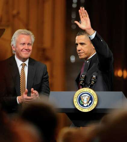 President Barack Obama waves to the  gathering of workers and dignitaries as GE CEO Jeffrey Immelt looks on at the GE plant in Schenectady January 21, 2011.   (Skip Dickstein / Times Union) Photo: SKIP DICKSTEIN / 00011832A