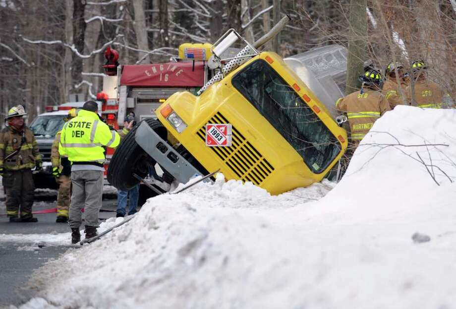 Emergency workers are at the scene of an overturned oil tanker on Holbrook Road, near Great Hill Road, in Seymour on Friday, Jan. 21, 2011. Photo: Autumn Driscoll / Connecticut Post