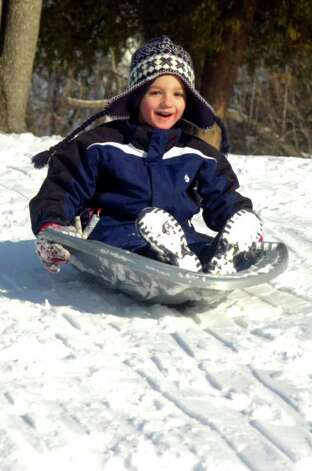 Colby LaSalle, 5, sleds on the hill behind the John B. Nichols Community Center in Trumbull on Friday, January 21, 2011. Photo: Lindsay Niegelberg / Connecticut Post