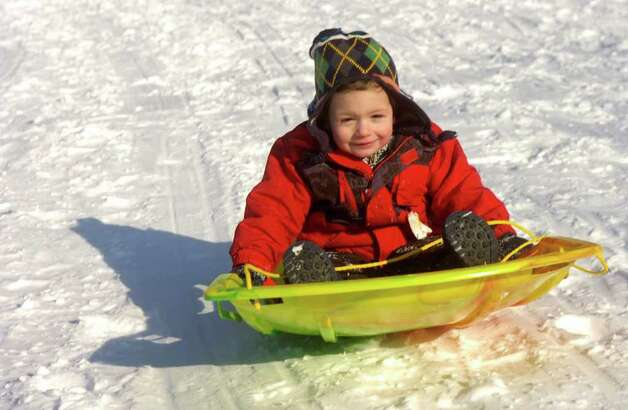 Gage LaSalle, 2, sleds on the hill behind the John B. Nichols Community Center in Trumbull on Friday, January 21, 2011. Photo: Lindsay Niegelberg / Connecticut Post