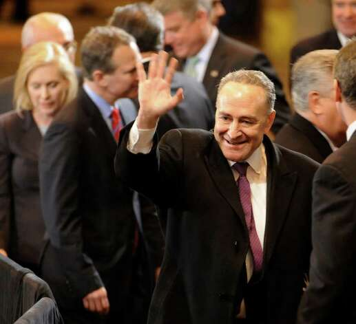 Senator Charles Schumer waves to the crowd as he arrives to hear the President speak at the GE plant in Schenectady January 21, 2011.   (Skip Dickstein / Times Union) Photo: SKIP DICKSTEIN / 00011832A