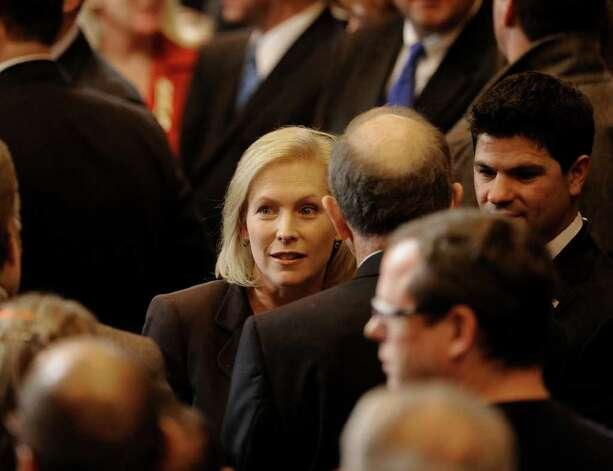 Senator Kirstin Gillibrand joins the gathering to hear President Barak Obama's speech at the GE plant in Schenectady January 21, 2011.   (Skip Dickstein / Times Union) Photo: SKIP DICKSTEIN / 00011832A