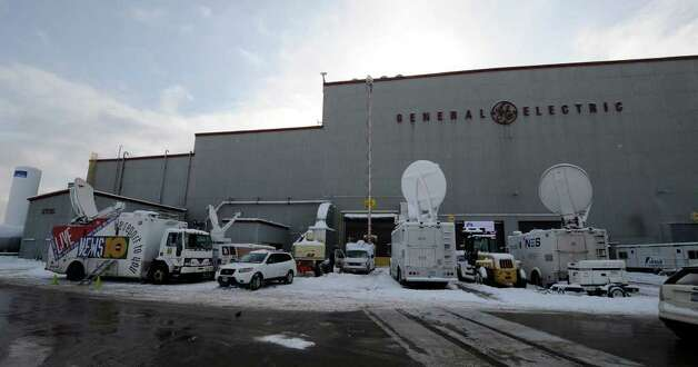 Satellite trucks from local TV and Networks lined the rear of building 273 to televise President Barak Obama's address to a gathering of workers and dignitaries at the GE plant in Schenectady January 21, 2011.   (Skip Dickstein / Times Union) Photo: SKIP DICKSTEIN / 00011832A