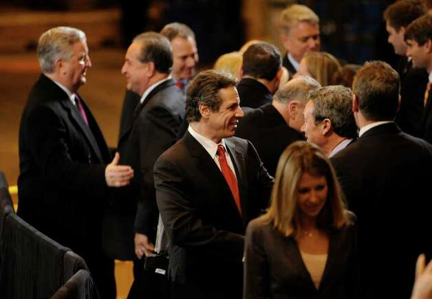 Governor Andrew Cuomo(c) speaks with Assemblyman Ron Canestrari before President Barak Obama's speech at the GE plant in Schenectady January 21, 2011.   (Skip Dickstein / Times Union) Photo: SKIP DICKSTEIN / 00011832A