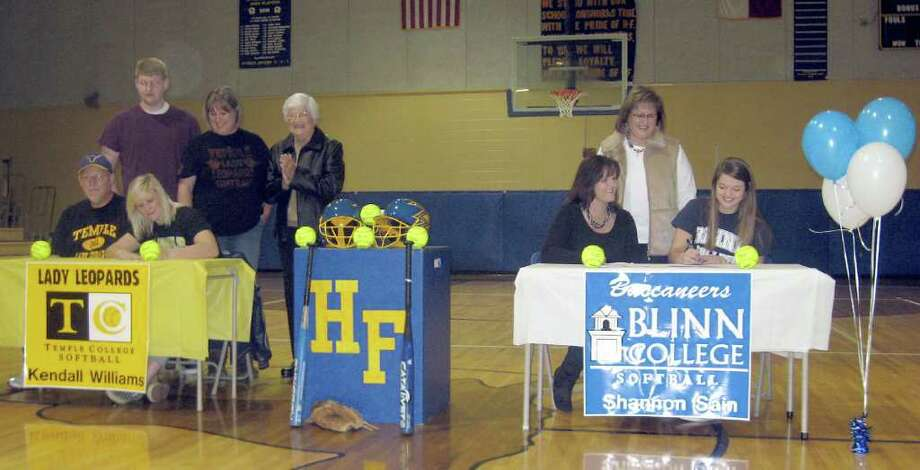 Hamshire-Fannett held its first ever softball signing ceremony. Kendall Williams, left, signed with Temple College. She is joined by her mother Denise Williams, father Terry Williams and brother Kameron Williams. Shannon Sain, right, is joined by her mother Tammy Sain and aunt Charlotte Sain.