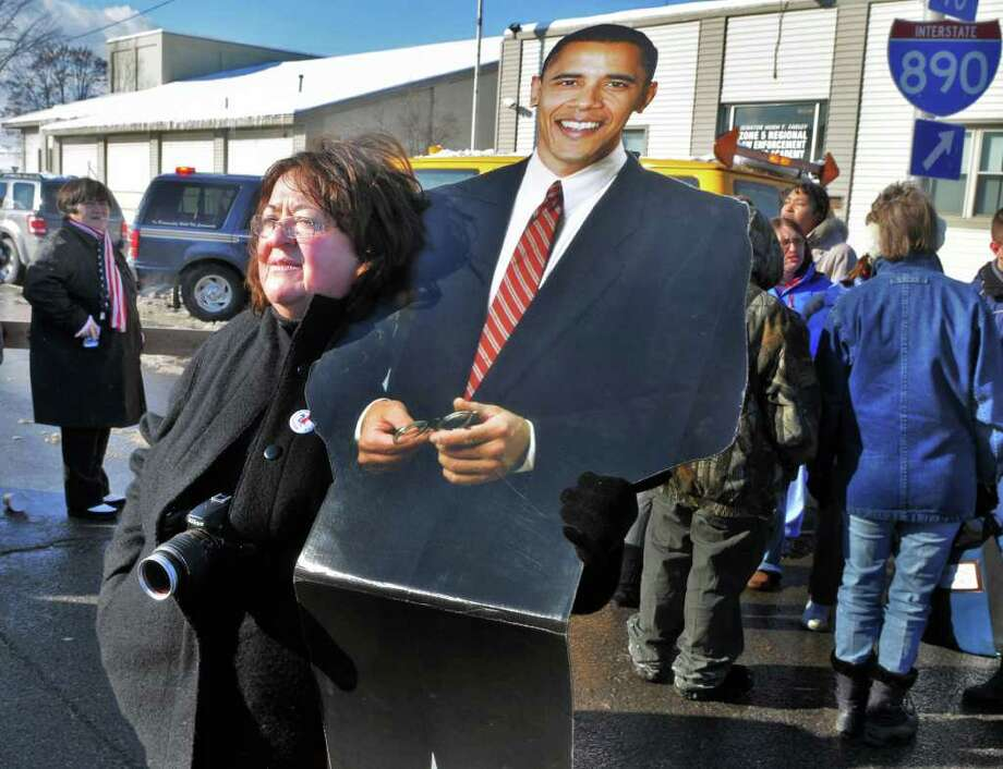 Retired school teacher Joann Perillo-Lasky of Schenectady holds a cardboard cutout of President Obama as she hopes to glimpse the Obama motorcade as it crosses the 890 overpass at Erie Blvd. in Schenectady Friday afternoon January 21, 2011.   (John Carl D'Annibale / Times Union) Photo: John Carl D'Annibale / 00011836A