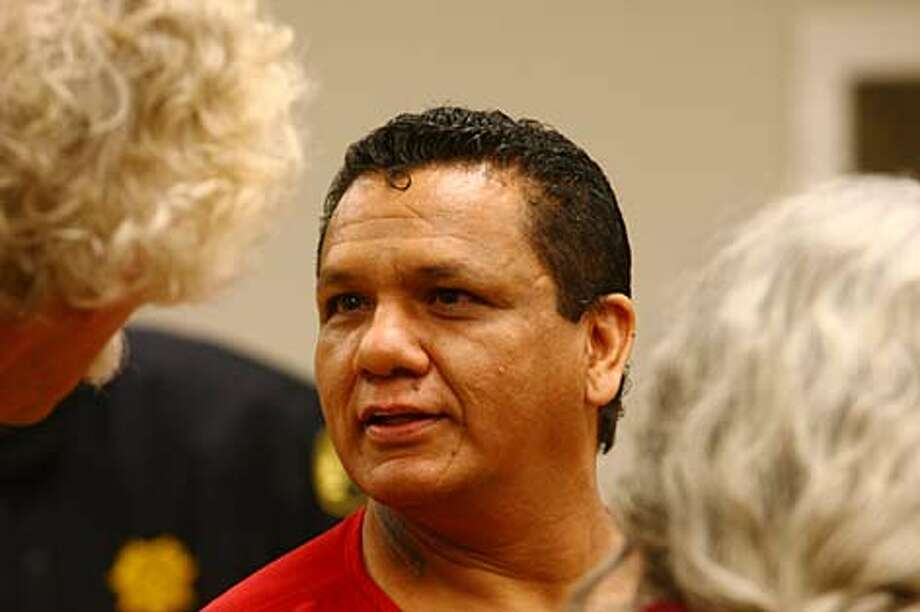 Salvador Cruz speaks with an attorney who assisted him in his defense prior to being sentenced Friday to 53 years in prison. Photo: Levi Pulkkinen/seattlepi.com