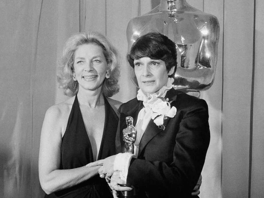 "Presenter Lauren Bacall with winner of Oscar for Best Costume Design, Theoni V. Aldredge, for the movie ""The Great Gatsby"" at the Academy Awards in Los Angeles Tuesday April 8, 1975. Photo: Anonymous, AP / 1975 AP"