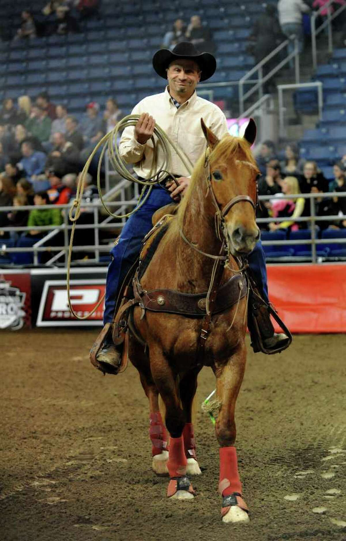 Runout man Pete Fontano, of Morris, Conn. and his horse Macho, during the Professional Bull Riders Touring Pro Division's Town Fair Tire Invitational at Webster Bank Arena at Harbor Yard in Bridgeport, Conn. on Friday January 21, 2011. The runout man's job is to keep the bulls in the yard and to corral them if necessary with his lasso. Fontano says that Macho is used to the bulls sometimes bumping into him.