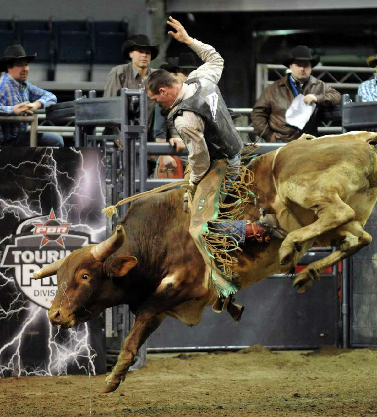 The Professional Bull Riders Touring Pro Division came to Webster Bank Arena at Harbor Yard in Bridgeport, Conn. for the Town Fair Tire Invitational on Friday January 21, 2011. Andrew Forcier, from Orange, rides True Gritt during the invitational.