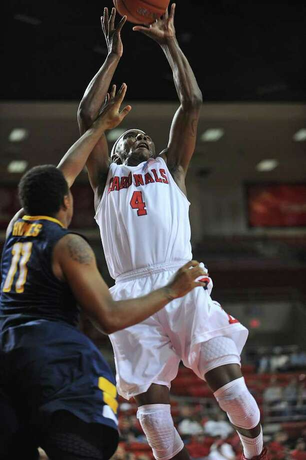 Lamar's Devon Lamb drives to the net against Division I Canisius at the Montagne Center Wednesday night.  Guiseppe Barranco/The Enterprise Photo: Guiseppe Barranco / Beaumont