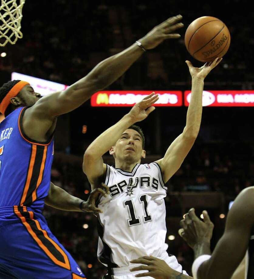 Spurs' Chris Quinn (11) takes a shot against New York Knicks' Bill Walker (05) in the first half at the AT&T Center on Friday, Jan. 21, 2011. Kin Man Hui/kmhui@express-news.net Photo: KIN MAN HUI, SAN ANTONIO EXPRESS-NEWS / kmhui@express-news.net