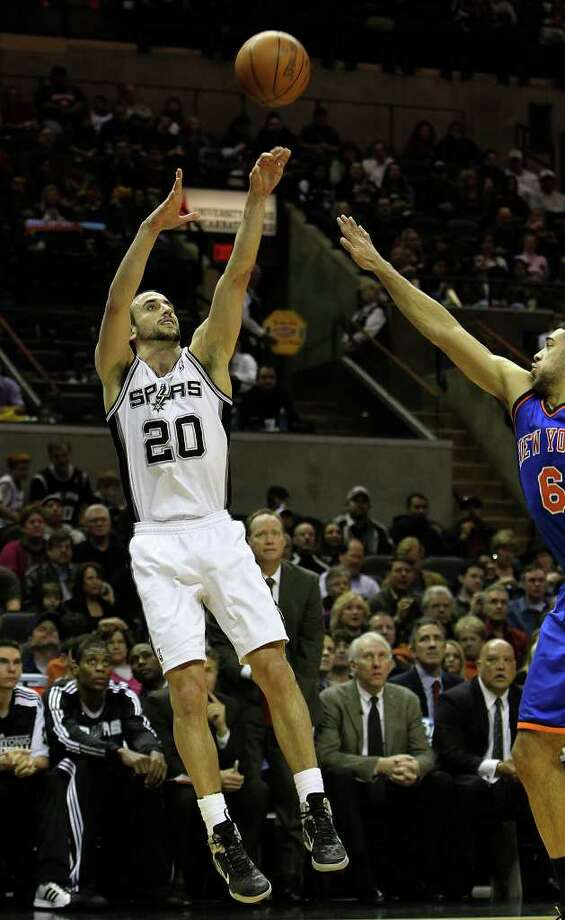 Spurs' Manu Ginobili (20) shoots over New York Knicks' Landry Fields (06) in the first half at the AT&T Center on Friday, Jan. 21, 2011. Kin Man Hui/kmhui@express-news.net Photo: KIN MAN HUI, SAN ANTONIO EXPRESS-NEWS / kmhui@express-news.net