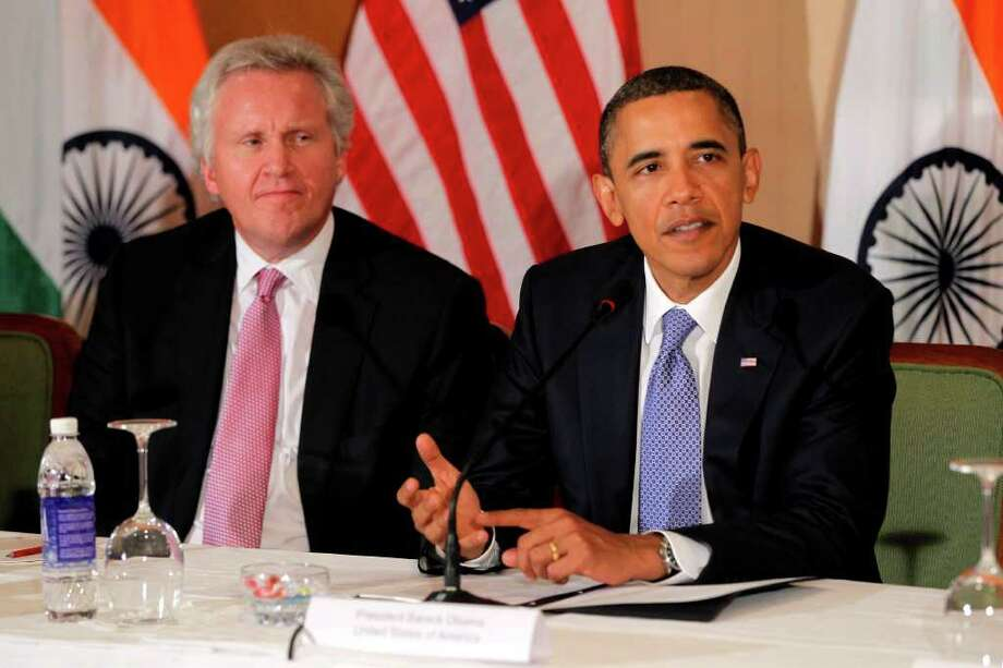 FILE - In this Nov. 6, 2010 file photo, General Electric's Jeffrey Immelt, looks on as President Barack Obama speaks at a roundtable discussion with business leaders in Mumbai, India. President Barack Obama is restructuring his economic advisory board and naming Immelt as it new head. (AP Photo/Charles Dharapak, File) Photo: Charles Dharapak, ST / AP