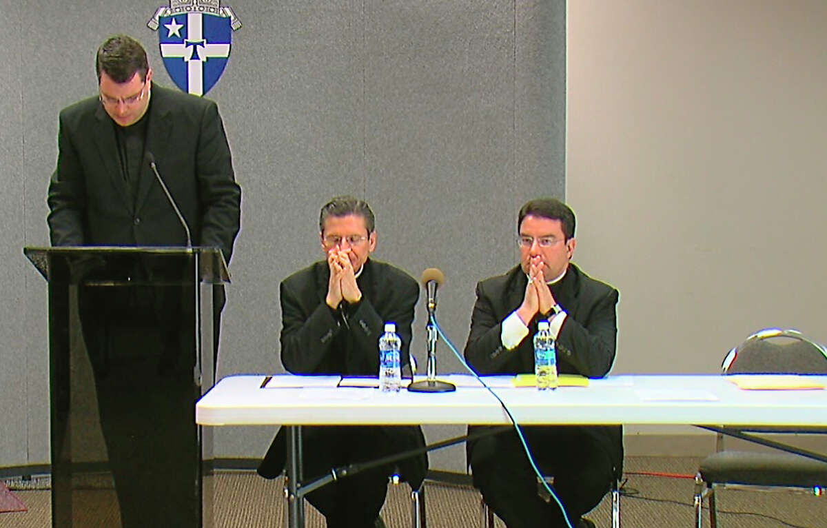 Father Martin Leopold (left), head administrator of the Archdiocese of San Antonio, says a religious order misled the archdiocese about Father John M. Fiala. Seated are Archbishop Gustavo Garcia-Siller (center) and Auxiliary Bishop Oscar Cantu.
