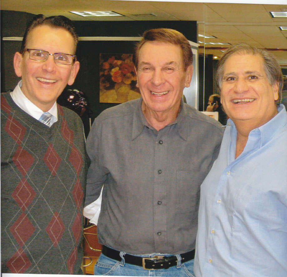 "From left: Barry Silverman, singer Freddy ""Boom Boom"" Cannon and Guy Sasson. Cannon, a popular rocker from the 50s and 60s, made a surprise visit Jan. 15 to the Guy Sasson Hair Salon on High Ridge Road in Stamford. Photo: Contributed Photo / Greenwich Time Contributed"