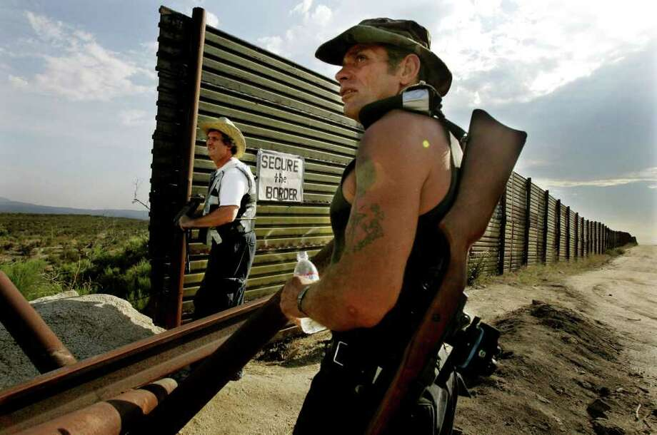 Border reform when nowhere in 2005, when armed California volunteers manned a border fense with Mexico. (Associated Press) Photo: SANDY HUFFAKER / AP