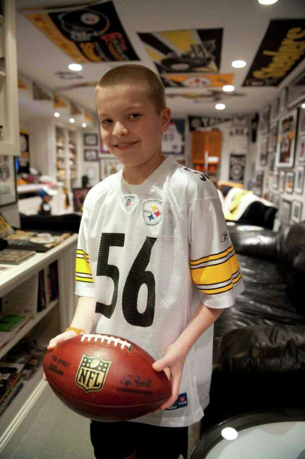 Jackson Trimmer holds a Ben Roethlisberger-autographed football Saturday Jan. 22 at home in Riverside, Conn. Photo by Douglas Healey/For Greenwich Time Photo: Douglas Healey, Douglas Healey/For Greenwich Tim / Greenwich Time