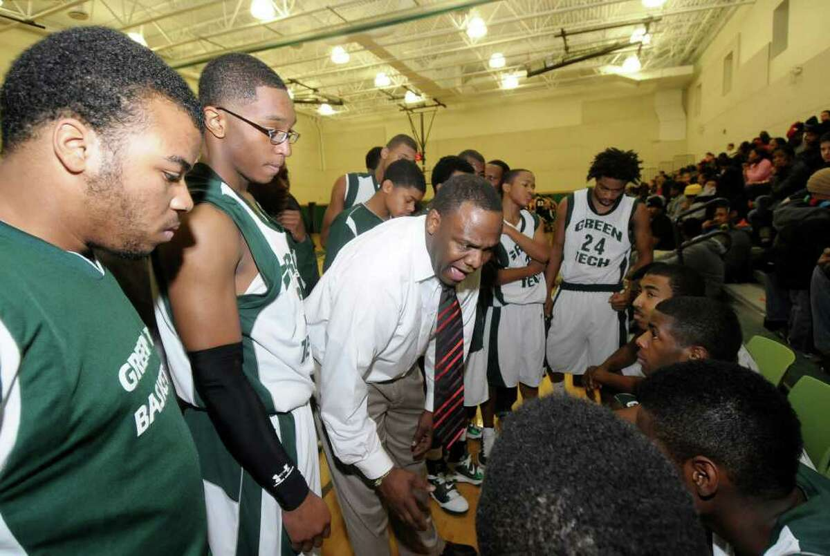 Green Tech High Charter School head coach Jamil Hood coaches his basketball team against Blessed Virgen Mary Academy of Syracuse during their game in Albany, N.Y., Thursday, Jan. 20, 2011. (Hans Pennink / Special to the Times Union)