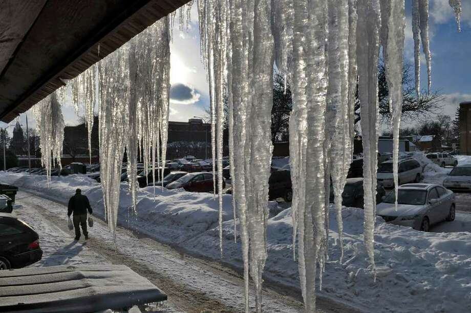 Large icicles hang from the rear of a building in Saratoga Springs on Sunday, Jan. 23, 2011. ( Philip Kamrass / Times Union ) Photo: Philip Kamrass