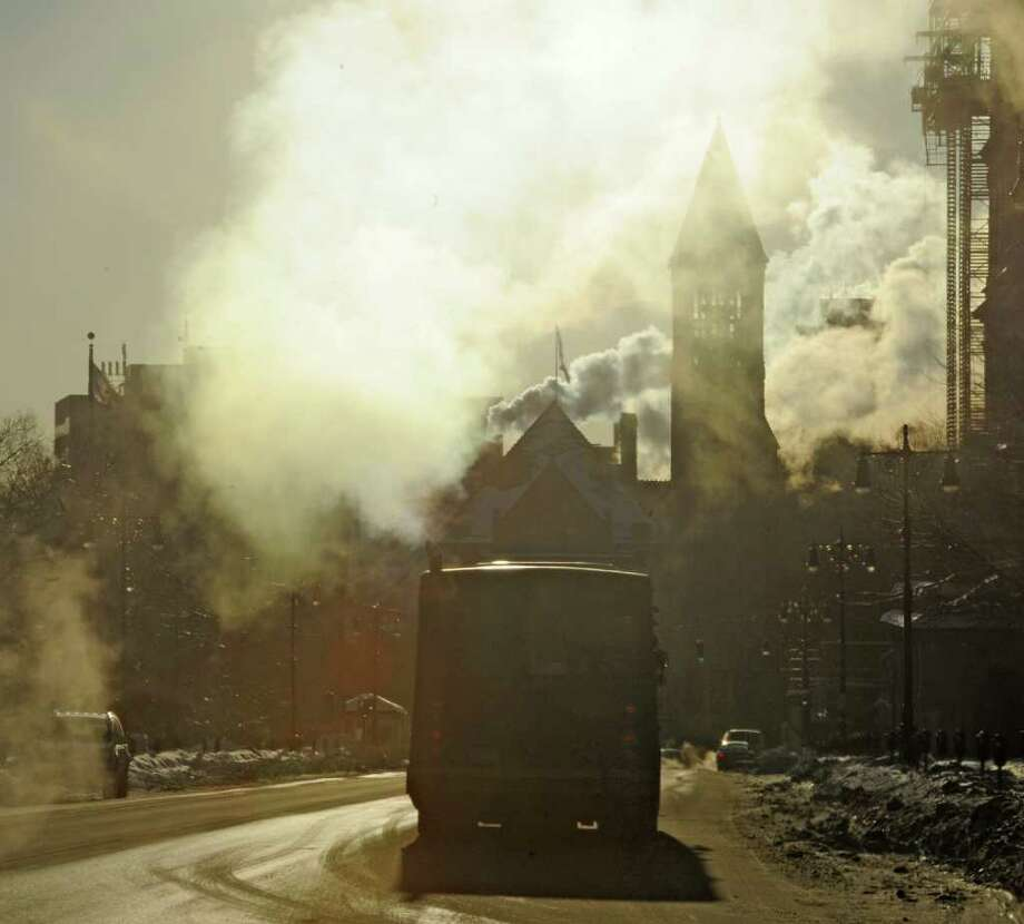 The chill is evident Monday in downtown Albany as steam rises from almost every building, silhouetting City Hall on the coldest day of the year.  (Skip Dickstein / Times Union) Photo: SKIP DICKSTEIN / 2008