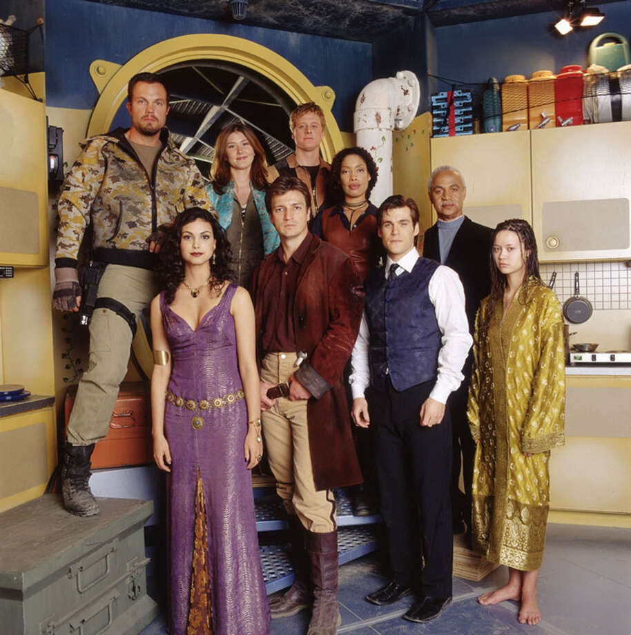 "The new one-hour science-fiction adventure series FIREFLY, premieres on FOX. (Courtesy photo) Clockwise from top left:  Adam Baldwin as Jayne, Jewel Staite as Kaylee, Alan Tudyk as Wash, Gina Torres as Zoe, Ron Glass as Book ""The Shepherd"", Summer Glau as River tam, Sean Maher as Simon, Nathan Fillion as Captain Malcolm ""Mal"" reynolds, and Morena Baccarin as Inara. Photo: Express-News"