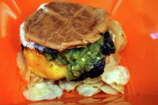 A cheese burger made with New Mexico Hatch chiles from Toastie Buns. Photo: JOHN DAVENPORT, SAN ANTONIO EXPRESS-NEWS / jdavenport@express-news.net