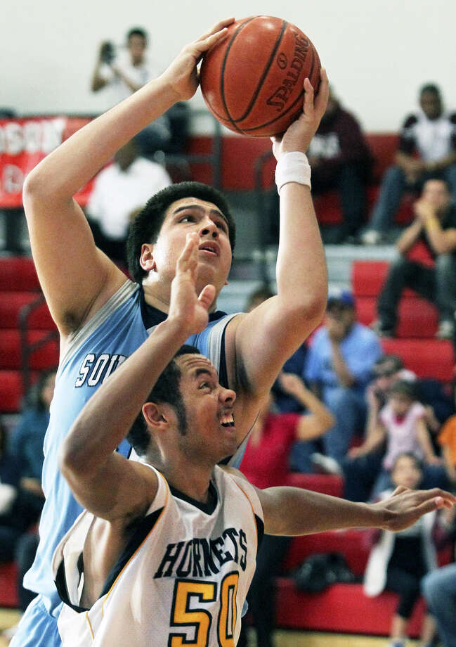 "South San center Gabe Garza puts up the game-winner against East Central, saying later of his post moves, ""At my size, it's not like I should be doing anything else."" Garza is 6-foot-9 and weighs 275 pounds. Photo: TOM REEL/treel@express-news.net"