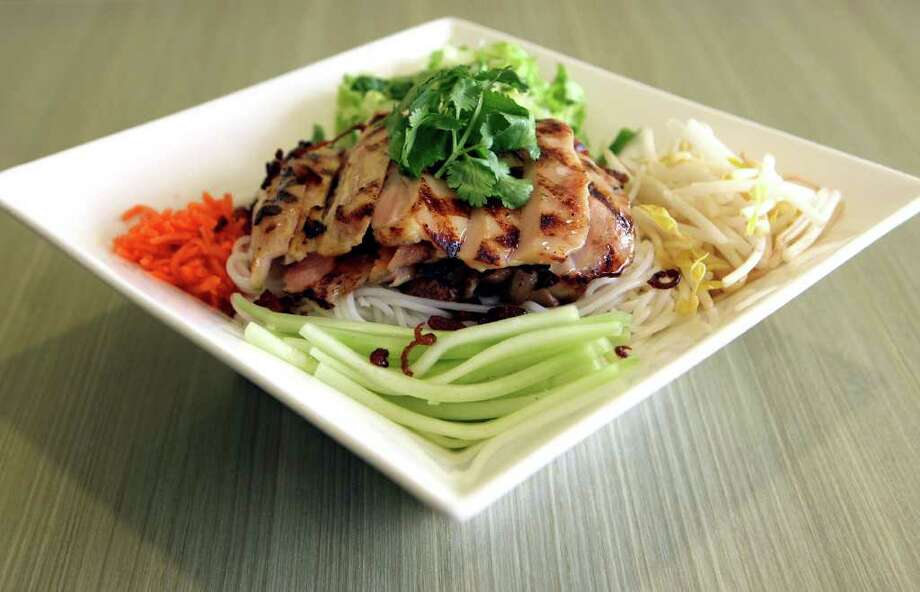 Bun features vermicelli-style noodles with freshly grilled chicken at House of Pho located at 7302 Louis Pasteur Dr., (210)617-4581. Visit houseofphosa.com Photo: HELEN L. MONTOYA, SAN ANTONIO EXPRESS-NEWS / hmontoya@express-news.net
