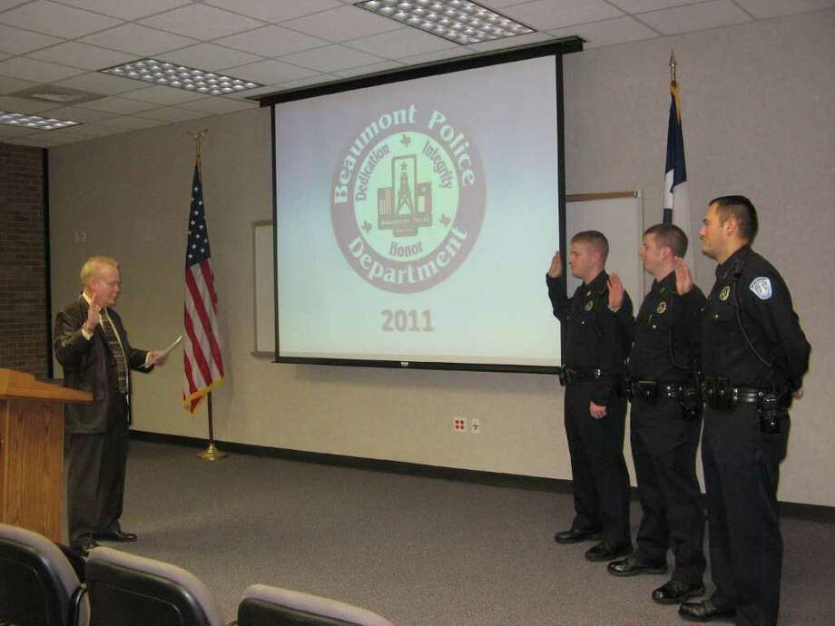 Beaumont Police Chief Frank Coffin address officers Monday, from left, Aron Porter, Matthew Roberts and Perry Stockwell, as they are sworn into the Beaumont Police Department. Joanne Liou/The Enterprise